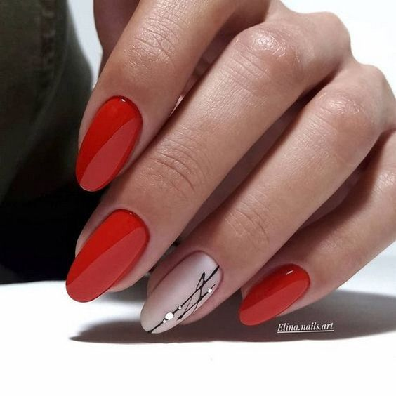Czerwone paznokcie z wzorkami