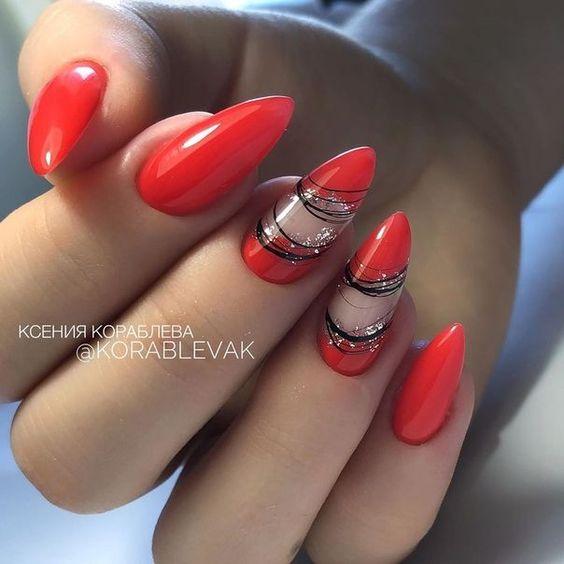 Czerwone paznokcie ze zdobieniami