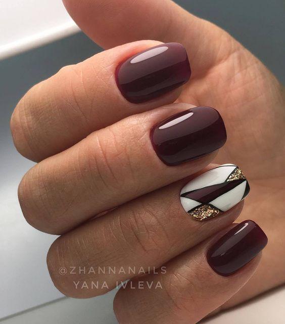 Bordowe paznokcie z geometrycznymi wzorkami