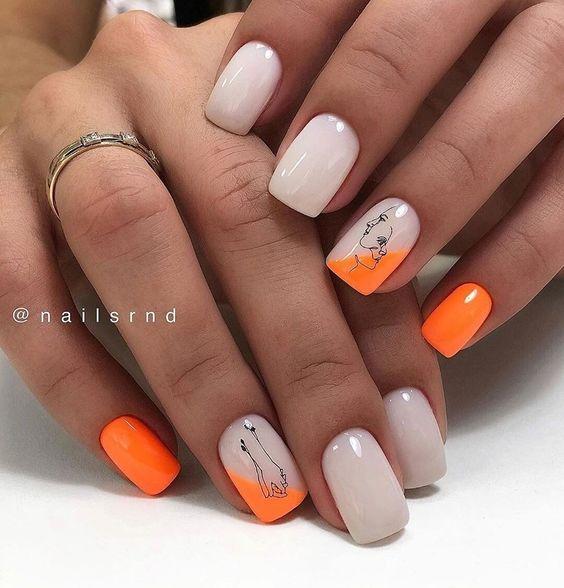 Naturalne paznokcie z pomarańczowymi wzorkami