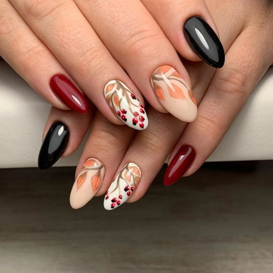 Bordowe paznokcie z wzorkami na jesień