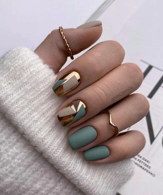 Matowe zielone paznokcie z wzorkami na jesień
